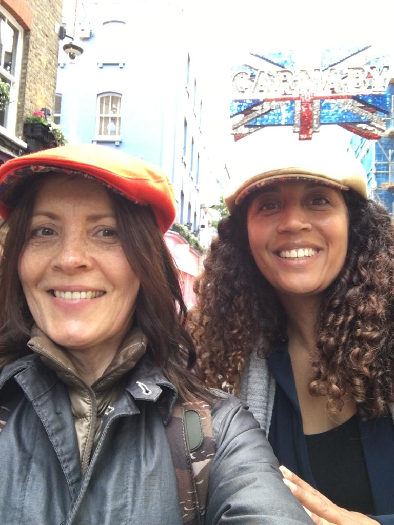 Rhian and Janine outside Libertys in Carnaby Street in our bespoke vintage liberty print caps