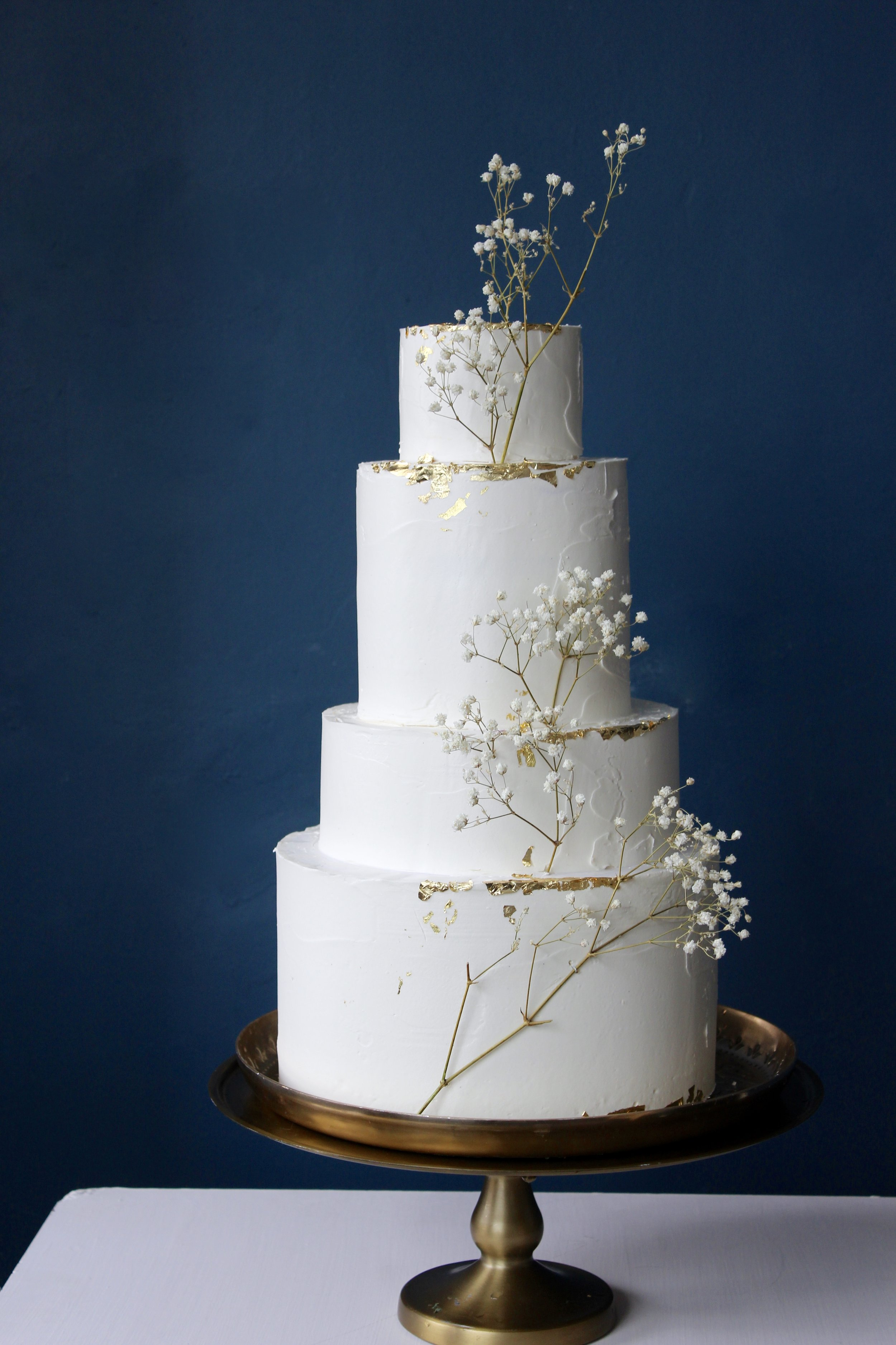 Four tier textured buttercream wedding cake with gold detail