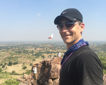Luke in Khajuraho, India enjoying a birds-eye-view of the Himalayan Institute temple and shrine.
