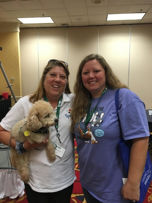 As part of our sponsorship we had the chance to pick a prize to auction off. We chose everyone's favorite - an Amazon gift card! Here's Kelly with the winner (rocking a Sparkie polo)