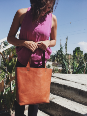 Classic leather tote in tan. It's crisp. It's timeless. It's leather. Enough said.