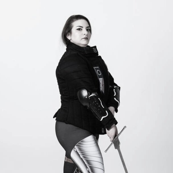 Marlene Hurst  instructs wrestling and longsword. She applies her background in the Cecchetti method of Ballet and Irish Step Dancing to inform body mechanics, awareness, and positioning.
