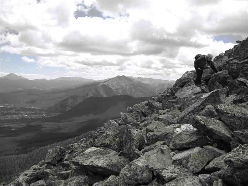 Photo by Chuck Demas. Susan J. Demas descending the Buffalo Mountain rock field, Colorado, August 2010.