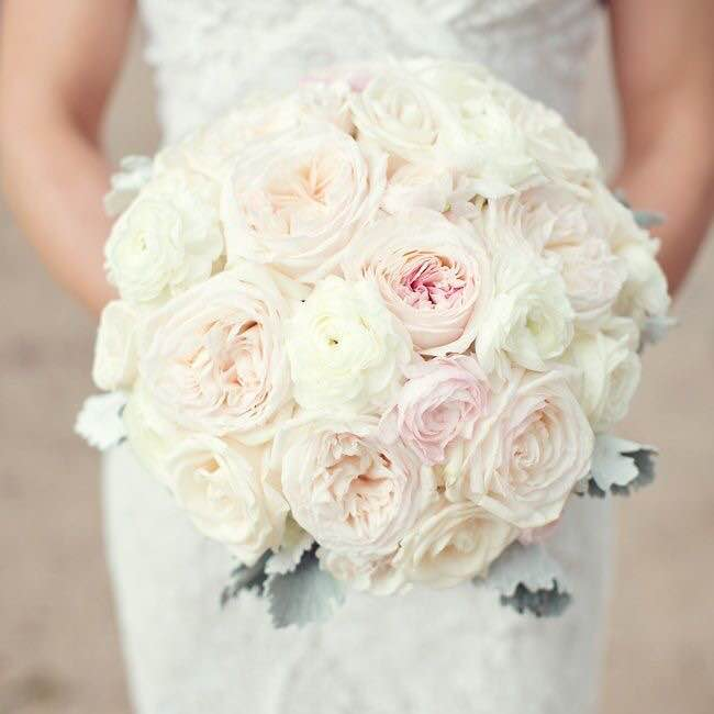 Guesses - $50 - $450    Average - $150    Actual cost - $325    As you can see, garden roses (which are very trendy right now) are much more expensive than the traditional roses in photo #1