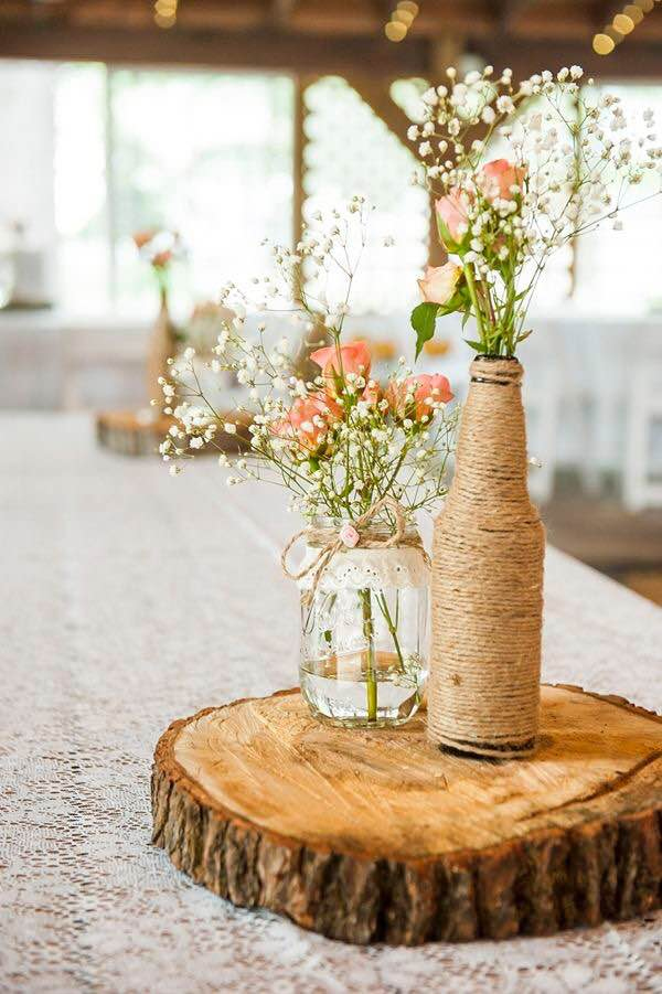 Guesses - $6 - $60    Average - $30    Actual cost - $20 per table     Much of the price on this would come from having to wrap twine around the bottle and decorating the mason jar