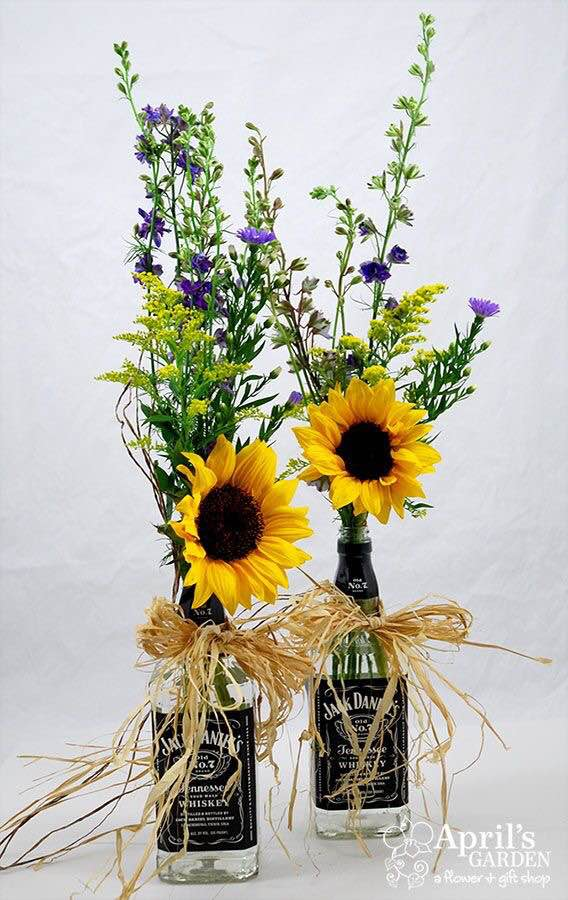 Guesses - $15 - $75    Average - $27.50    Actual cost - $30 per table     Wine bottles as vases are very popular, but I haven't used liquor bottles. I would hope the couple would help me drink enough to provide them with these as vases