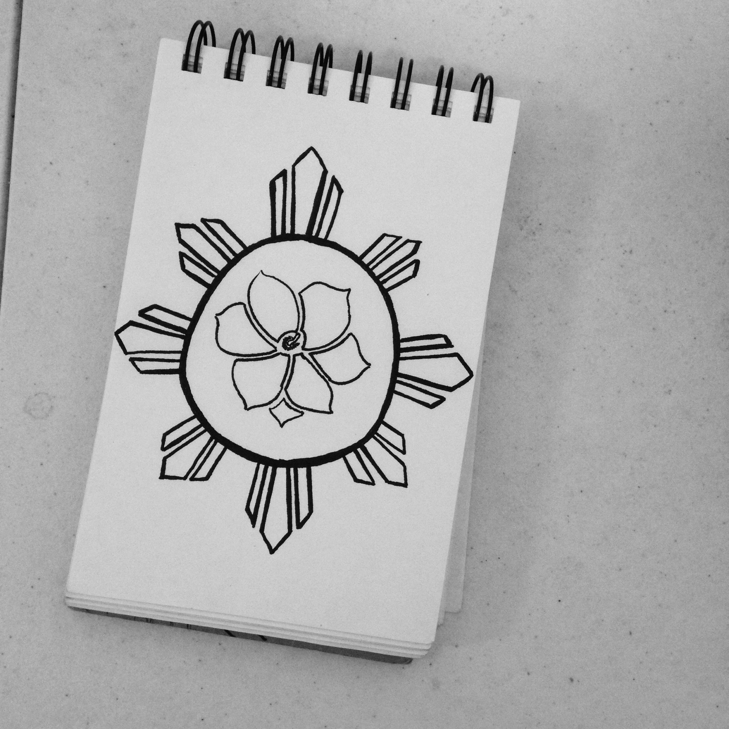 still working on this piece. it's a sun with a sampaguita in it.