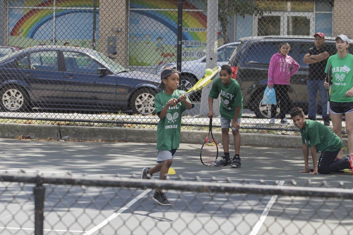 Members of the Kings County Tennis League hone their skills in Brooklyn on the corner of Marcy and Nostrand Aves. (ALEX RUD/FOR NEW YORK DAILY NEWS)