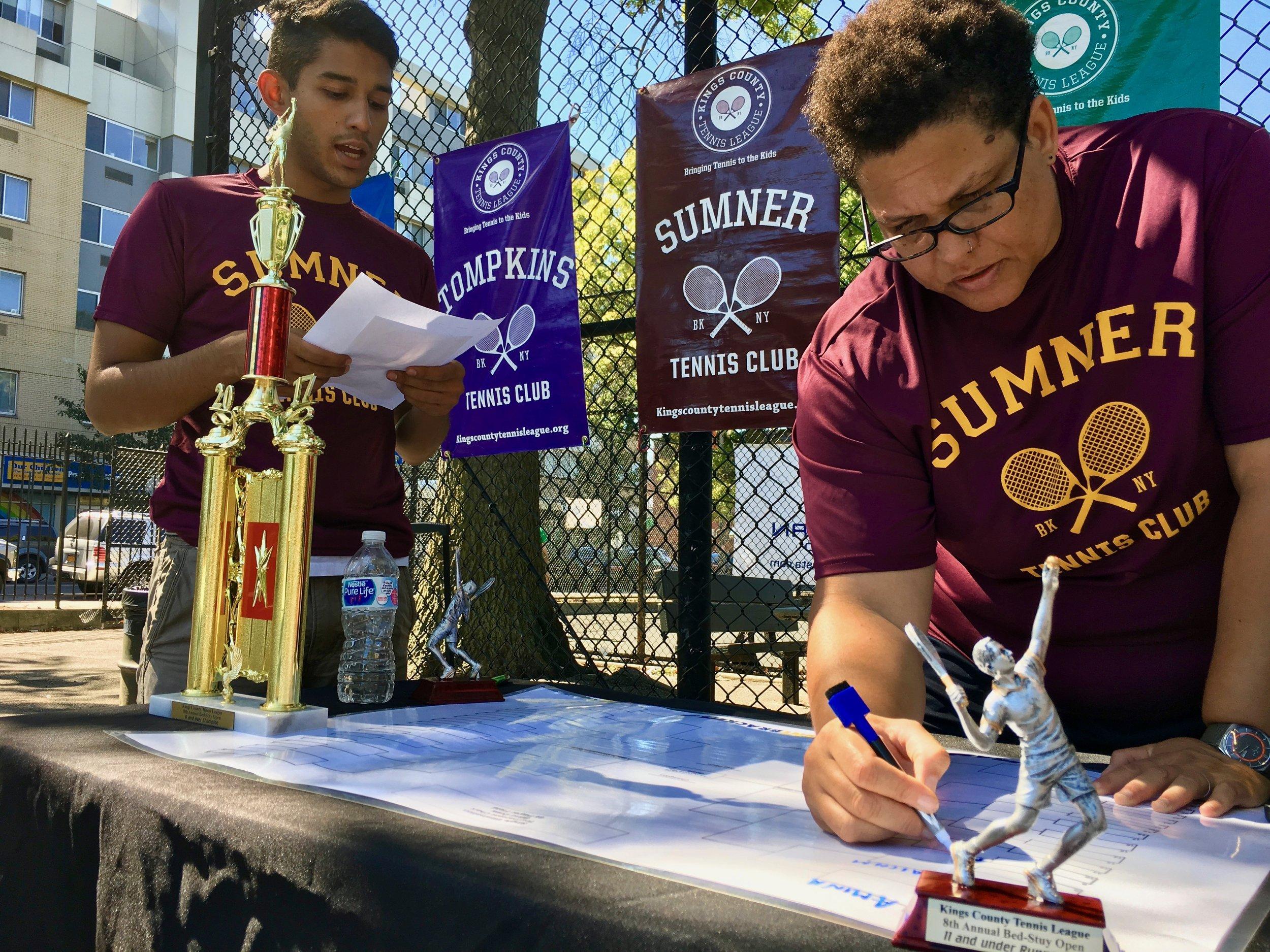 Michael Rojas and Kim Diehl prepare the Jamboree tournament draw.