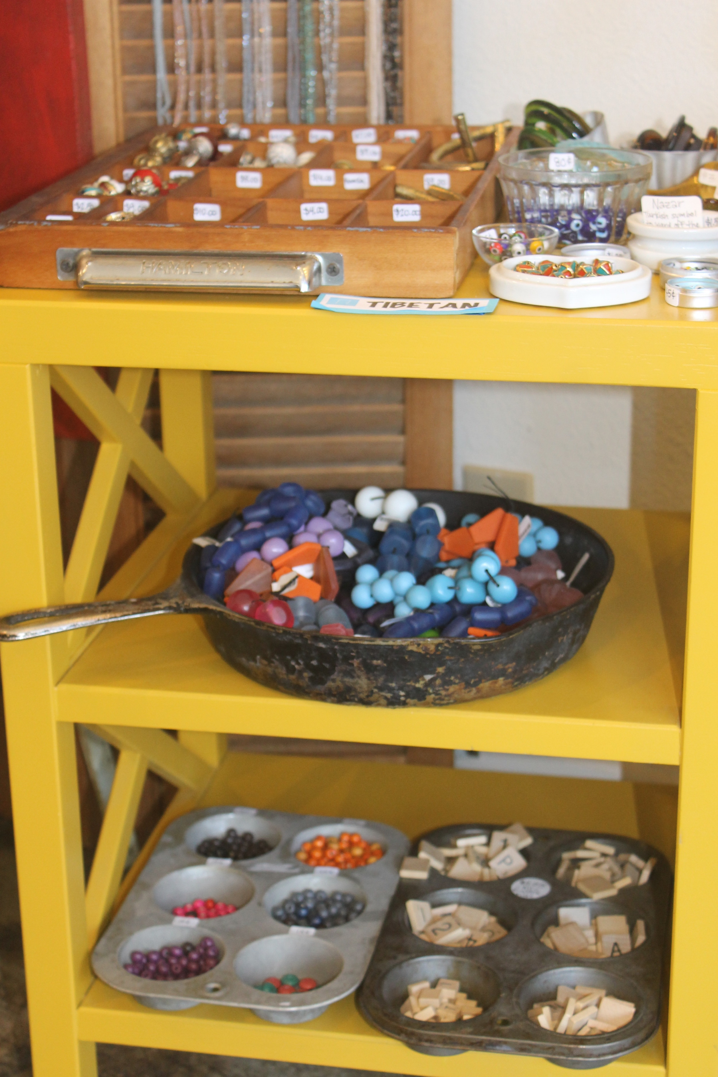 Blue Door Beads cleverly uses kitchen supplies as props to merchandise their product