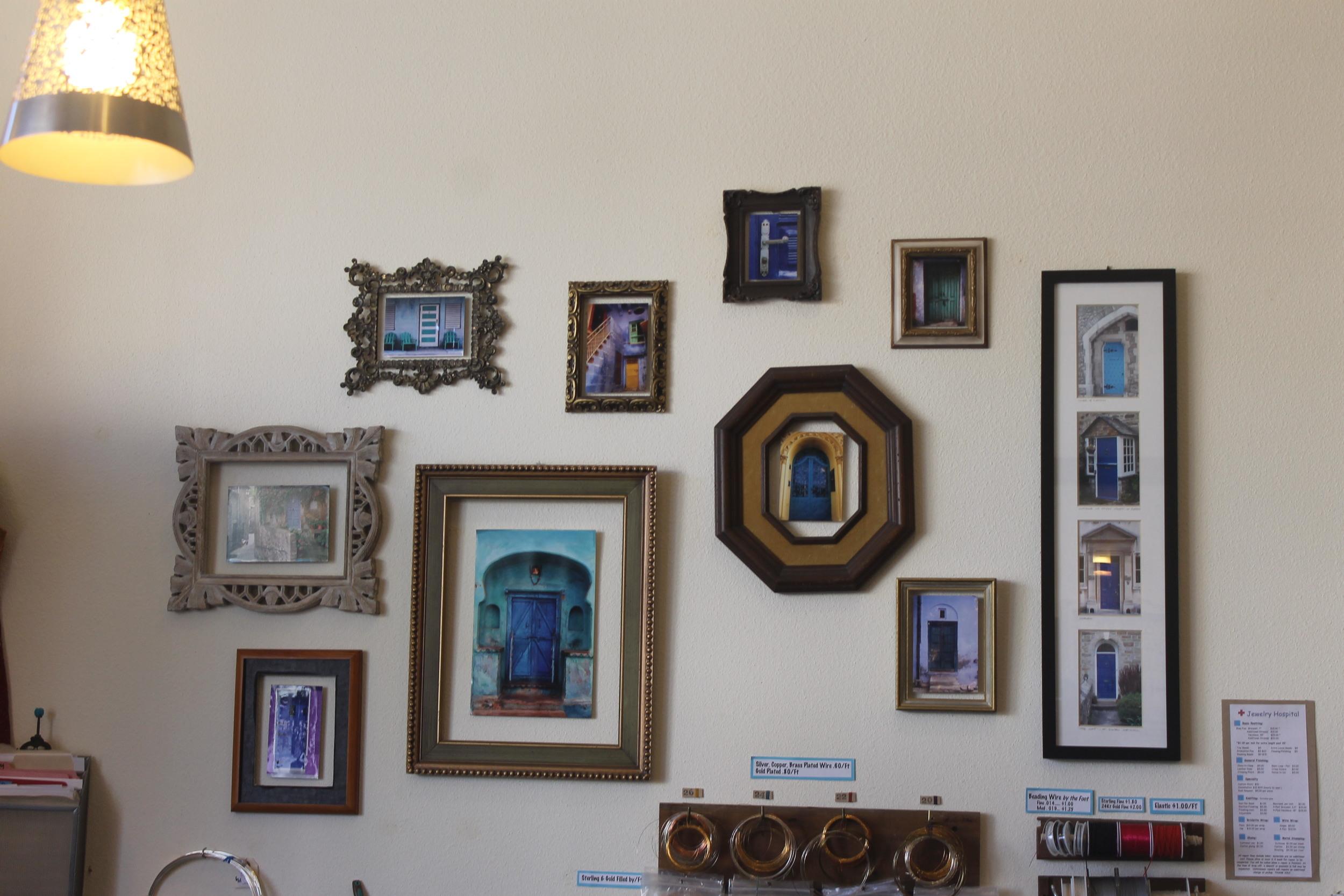 A gallery of blue door photos hang behind the cash wrap