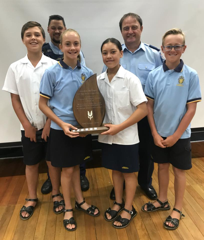 Fairfield Intermediate team members receiving the Douglas Grant Memorial Trophy with Constable Jacob Goldsmith (left)and Constable Calum Grant.