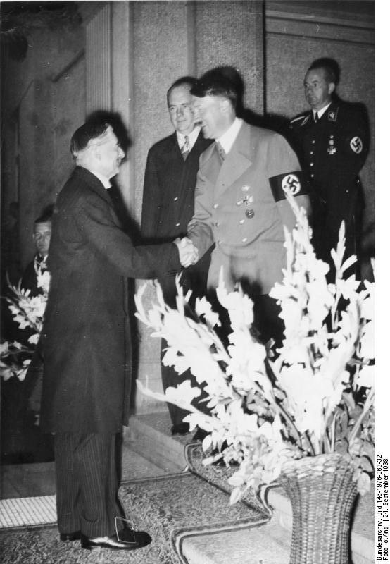 British Prime Minister Neville Chamberlain meets with Adolf Hitler September 24, 1938. Source: Wikimedia Commons