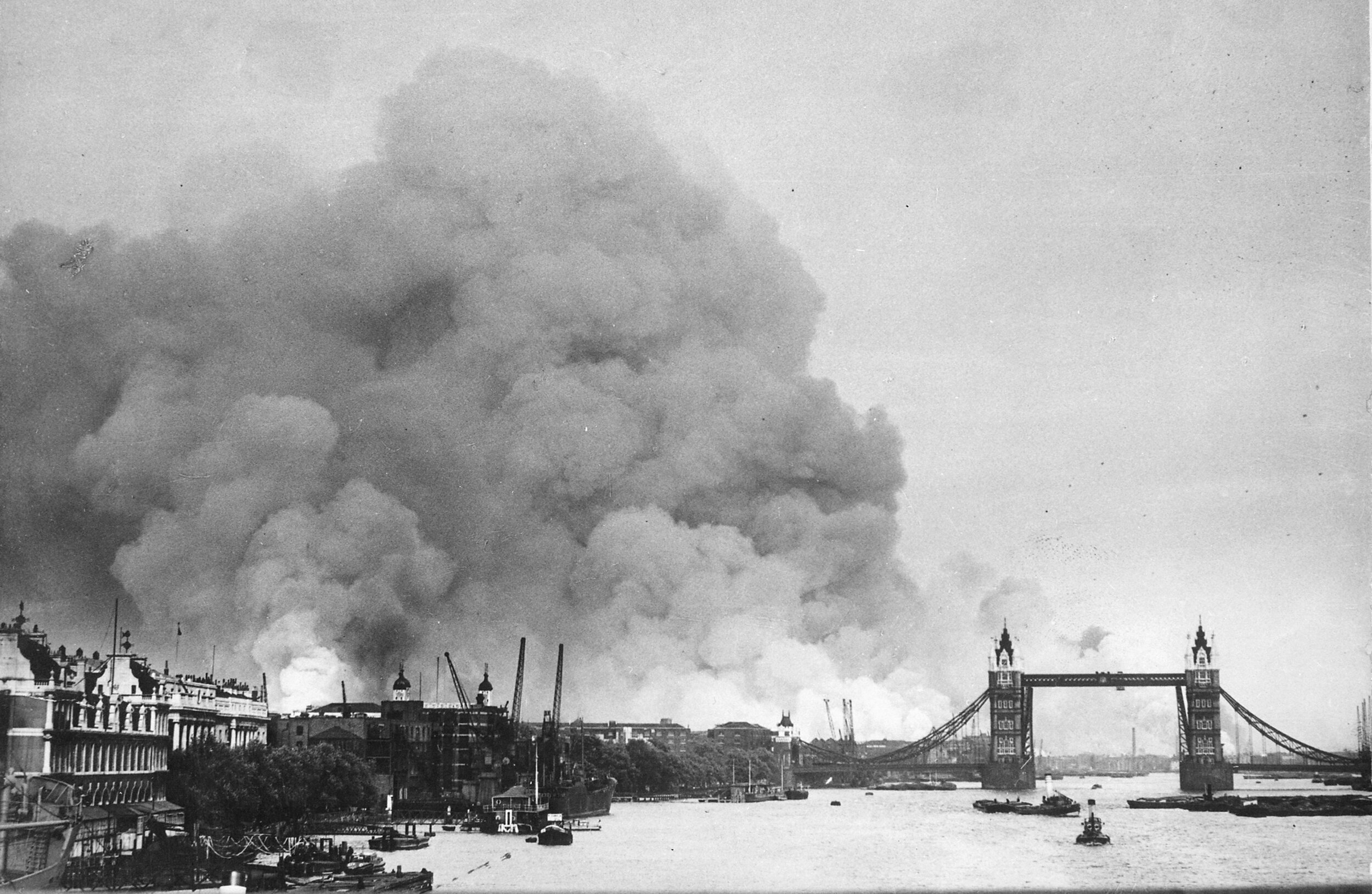 Smoke rising from fires in the London docks, following bombing on 7 September, 1940. By New York Times Paris Bureau Collection. Image courtesy of Wkimedia Commons.