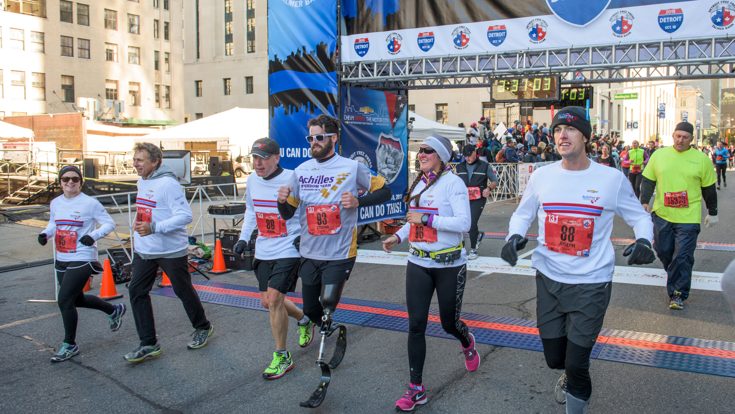 Freedom Team crossing the Detroit Marathon finish line