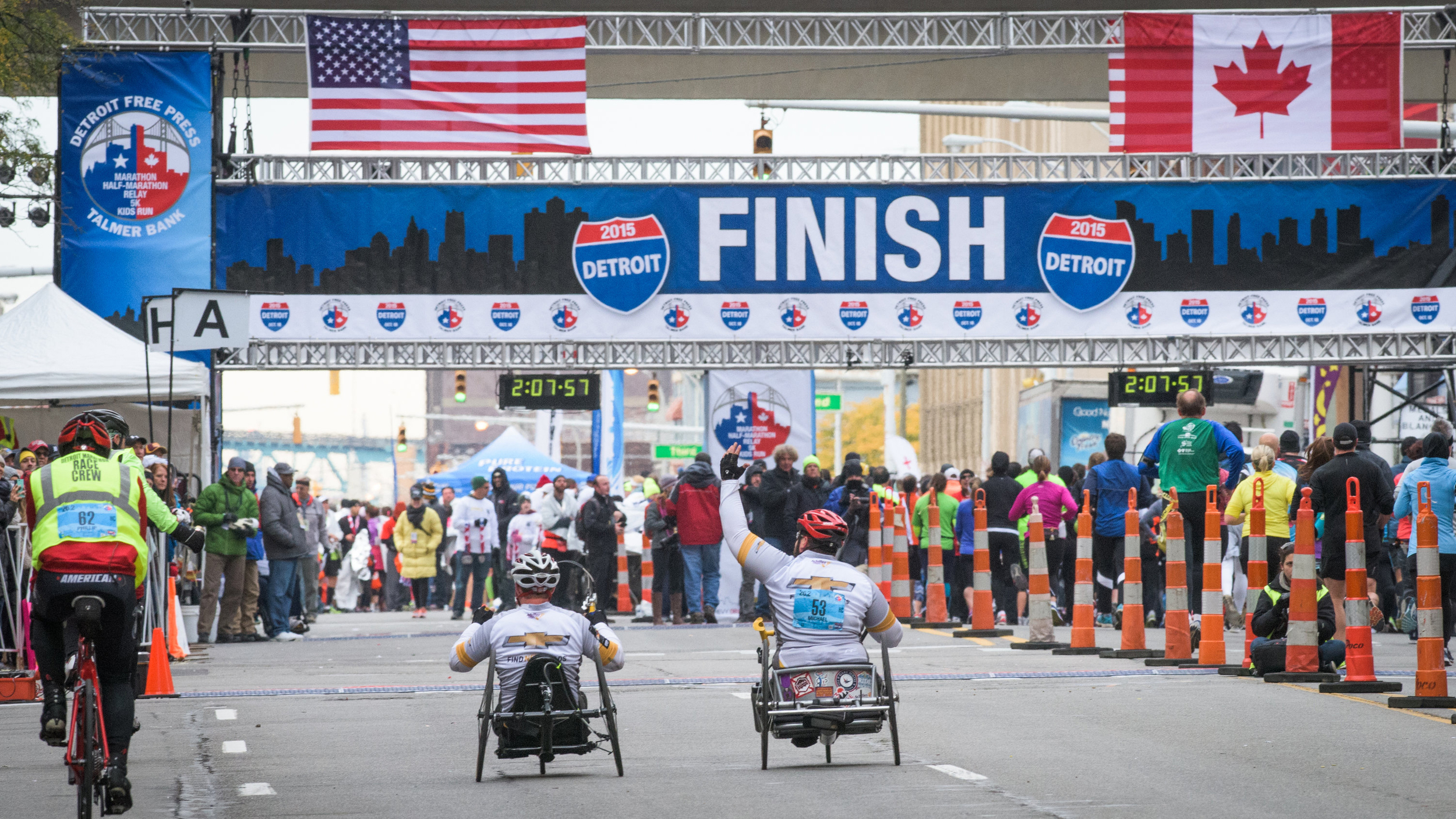 2 Freedom Team Handcycle Athletes crossing the Detroit Marathon finish line