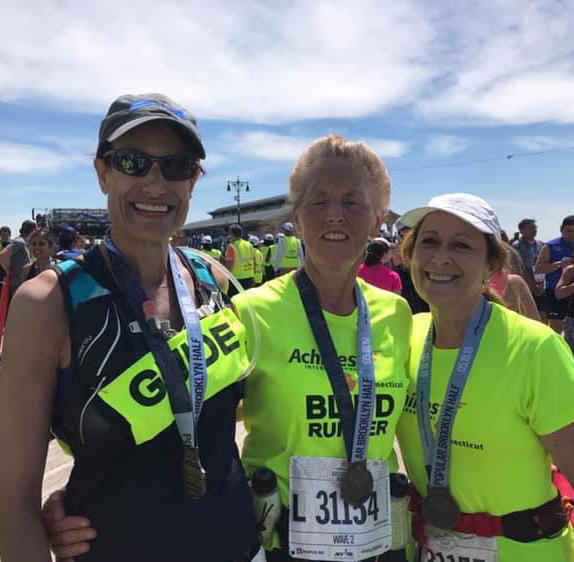 Above: Achilles Connecticut at the 2019 Popular Brooklyn Half Marathon. L - R. Aviva Elkayam (guide), Susanne Cesana, (VI athlete) and Mary Drake (guide)