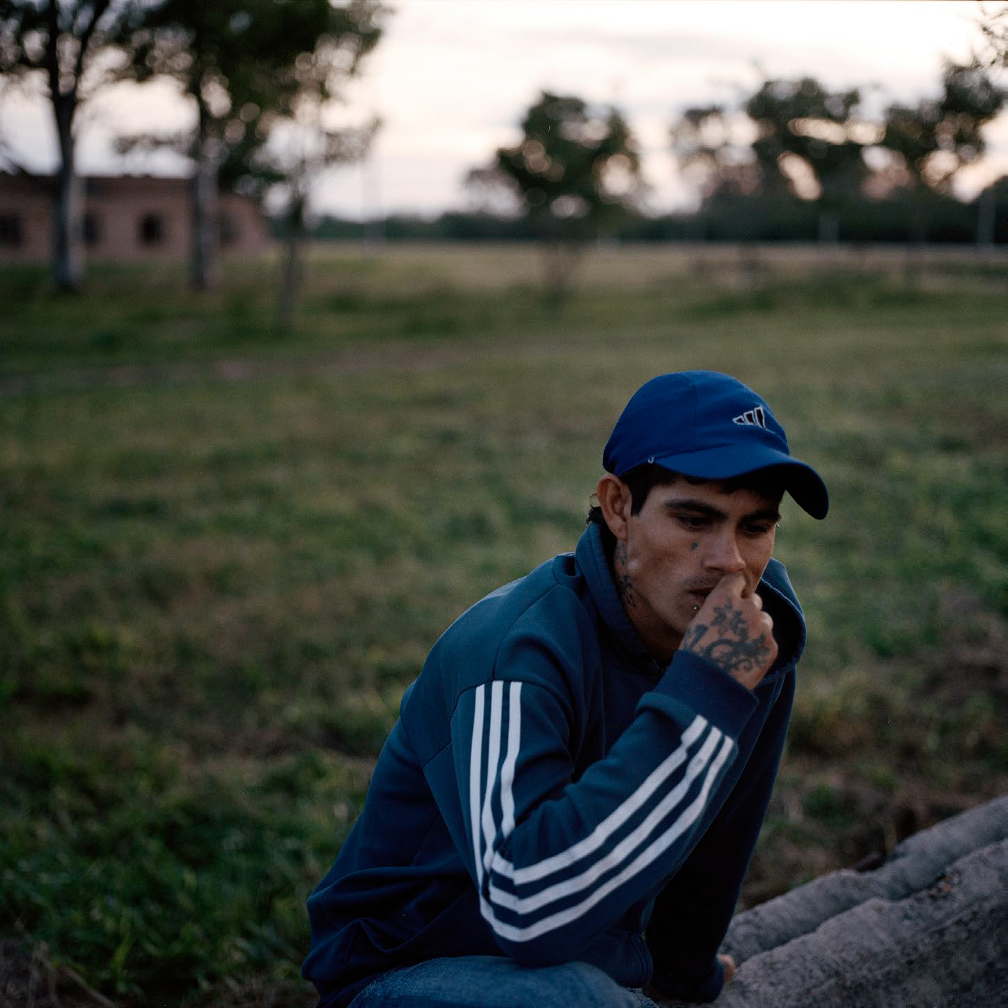 Maximiliano Fernandez, 21, near his girlfriend's house in Aviá Teraí where he lives with her family. There are few job opportunities in Aviá Teraí but Maximiliano works every now and then in the wood and charcoal industry in more remote areas, and is considering going to Buenos Aires to work, where his brother lives