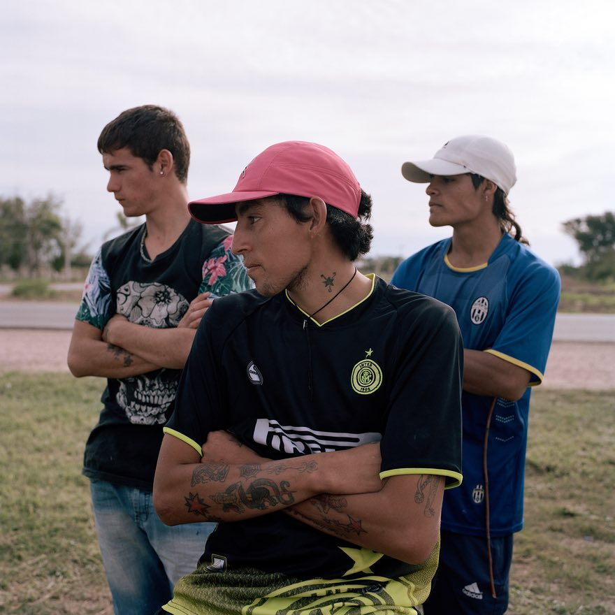 - 'A group of young men kill time in Aviá Teraí, Chaco province. Large-estate soya plantations surround the town, which has a population of around 6,000 and no running water. Unemployment rates here are very high and a large number of the inhabitants depend on government handouts'