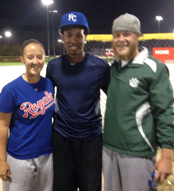 Contributed photo  Taylor Hill, left, and her twin brother Tyler Hill, right, pose for a picture with Kansas City Royals pitcher Yordano Ventura whomade a surprise appearance Friday, Oct. 30 at Tiffany Springs Softball in Kansas City, Mo. He played in two slow-pitch softball games and interacted with fans just two days after Kansas City lost the World Series in Game 7 to the San Francisco Giants.