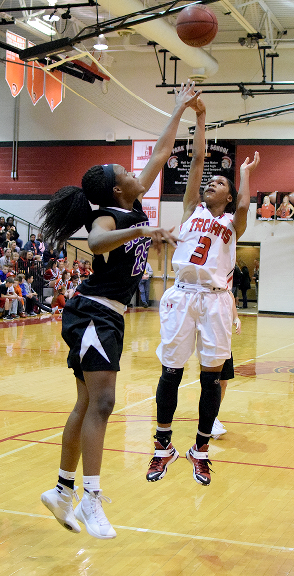 BRYCE MERENESS/Citizen photo Park Hill guard Gigi Hopkins (3) takes a shot over Park Hill South's Alecia Westbrook on Friday, Feb. 12 at Park Hill High School.