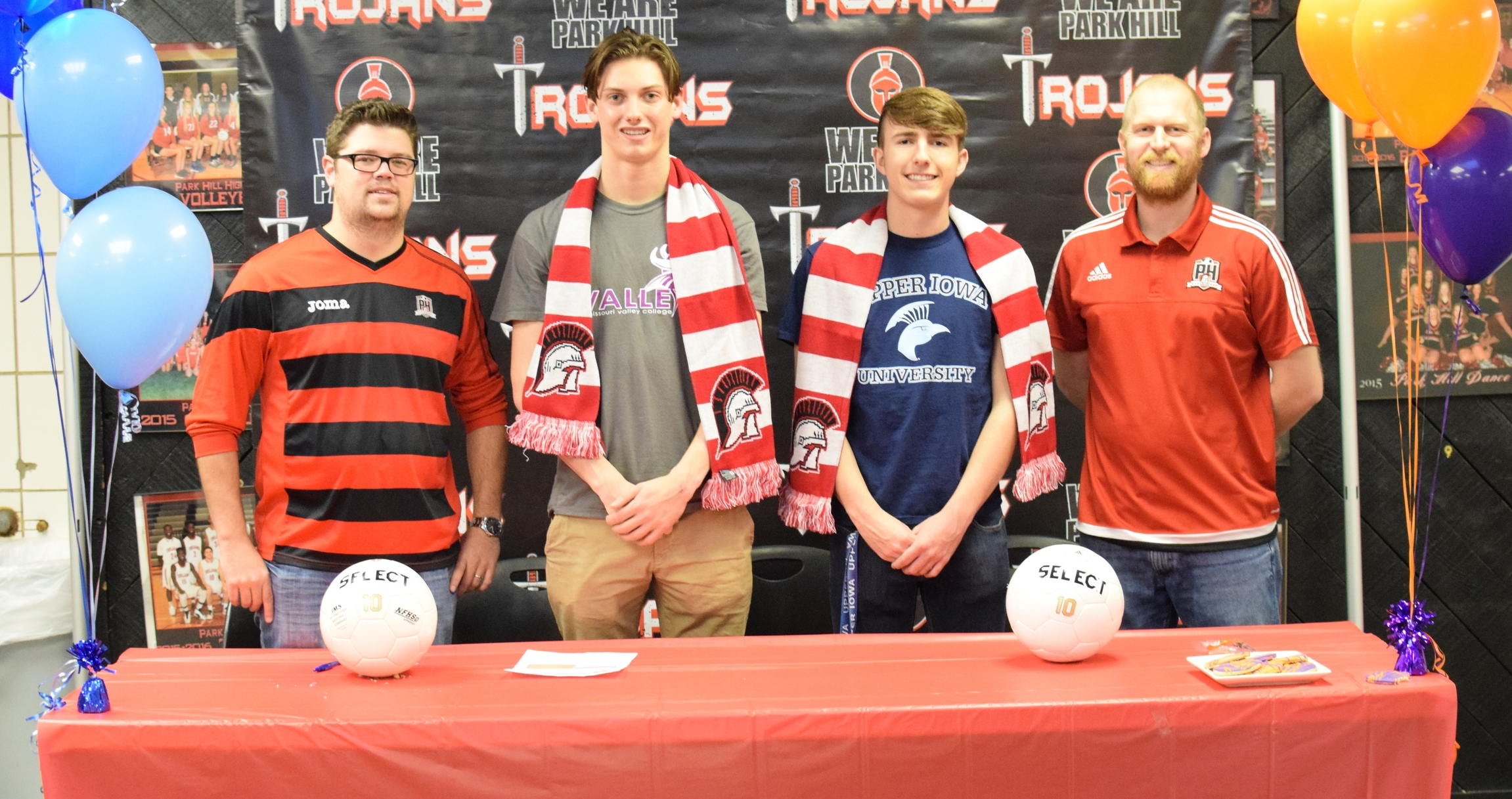 BRYCE MERENESS/Citizen photo Park Hill seniors Peyton LaFerla, left center, and Christian Fullmer, right center, recently signed to play collegiate soccer in a ceremony held Friday, Feb. 26 at Park Hill High School in Kansas City, Mo. LaFerla signed at Missouri Valley, an NAIA school, while Fullmer inked his commitment to Upper Iowa, an NCAA Division II program
