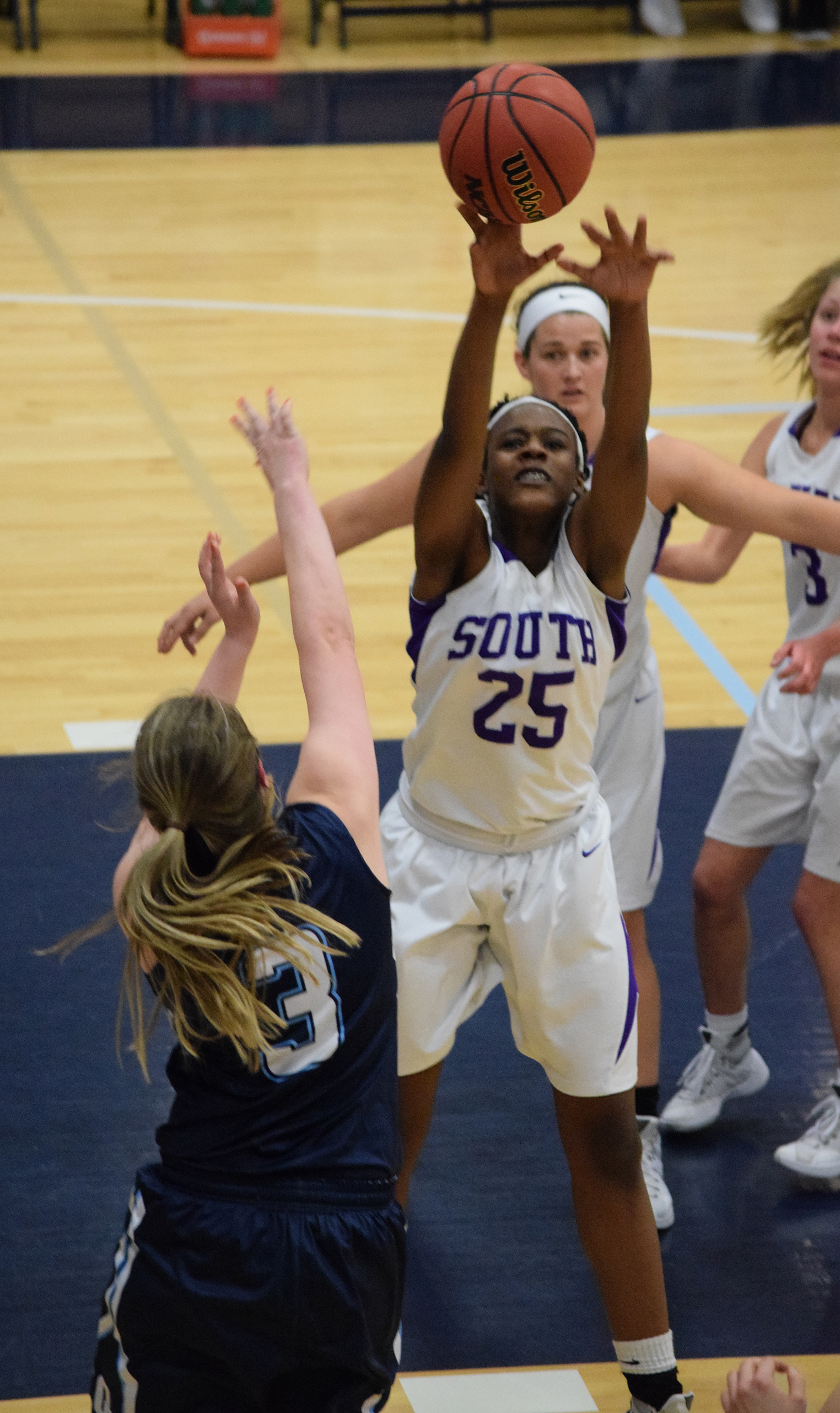 BRYCE MERENESS/Citizen photo Park Hill South freshman Alecia Westbrook (25), blocks a shot against Oak Park in the first round of the Class 5 District 16 tournament on Monday, Feb. 29 at Oak Park High School in Kansas City, Mo.