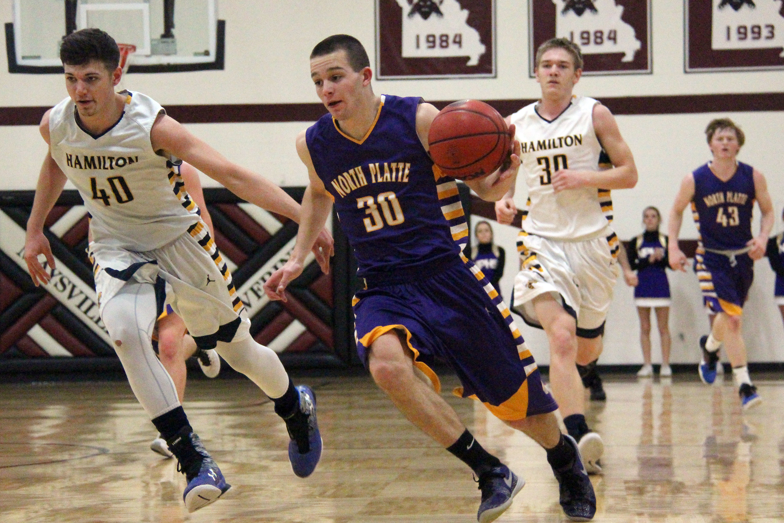 ROSS MARTIN/Citizen photo North Platte senior forward Kyle Ewing, center, dribbles up the court in a Class 2 District 16 semifinal game against Hamilton on Thursday, Feb. 25 at Maysville High School in Maysville, Mo.
