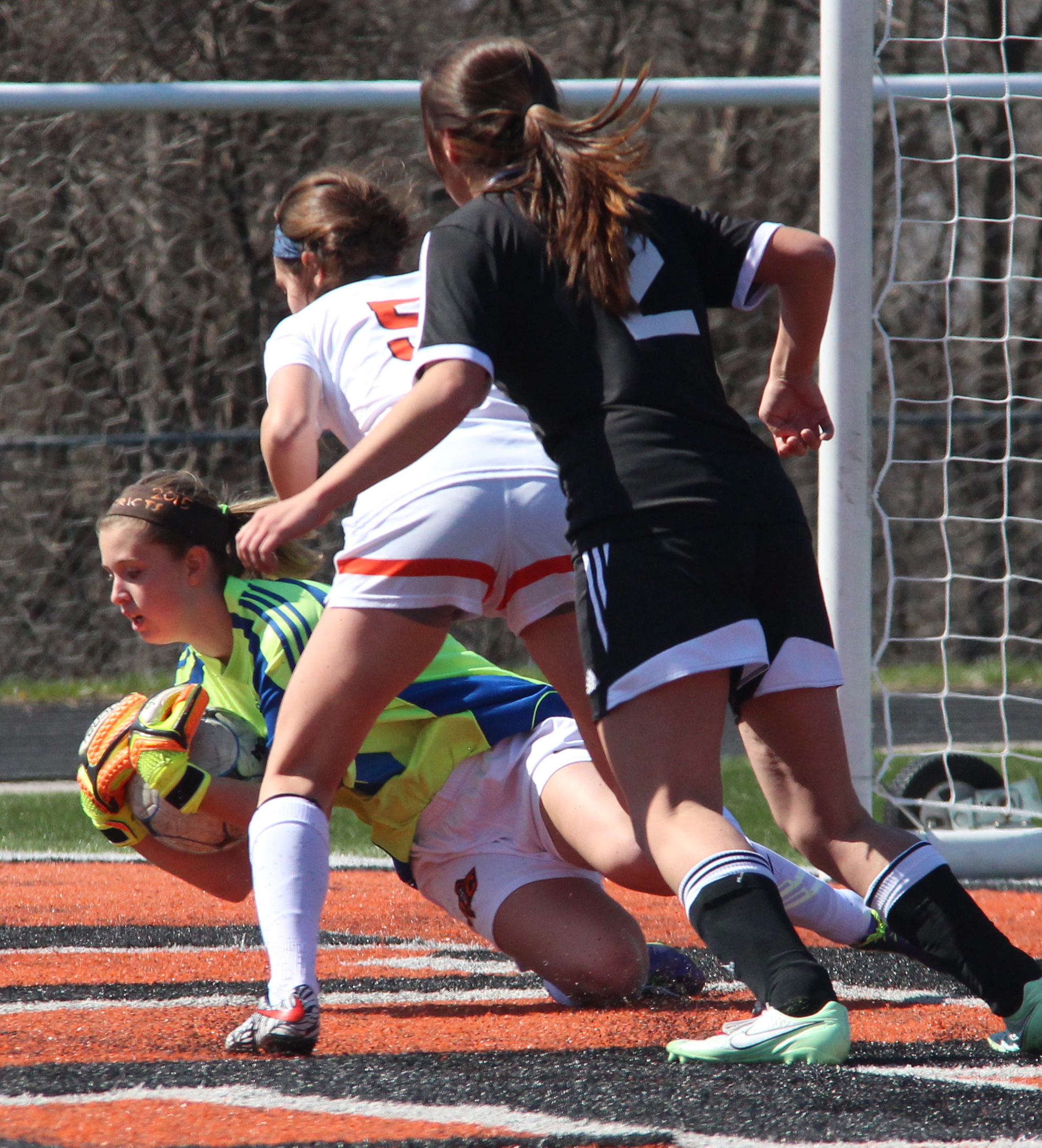ROSS MARTIN/Citizen photo Platte County sophomore goalkeeper Kaylyn Hathaway collects a loose ball during a Platte County Invitational pool play game against Staley on Monday, March 21.