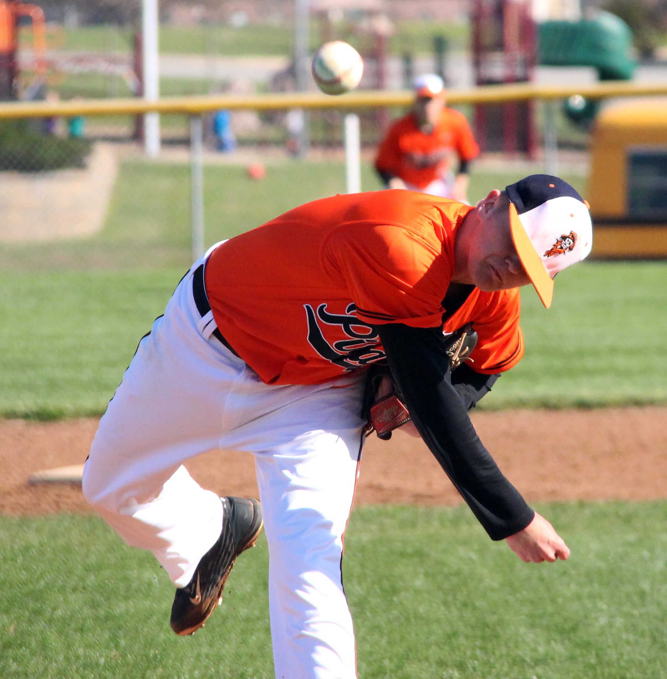 ROSS MARTIN/Citizen photo Platte County junior Jared Wilson follows through on a pitch against Oak Grove during a game Monday, March 28 at Platte County High School.