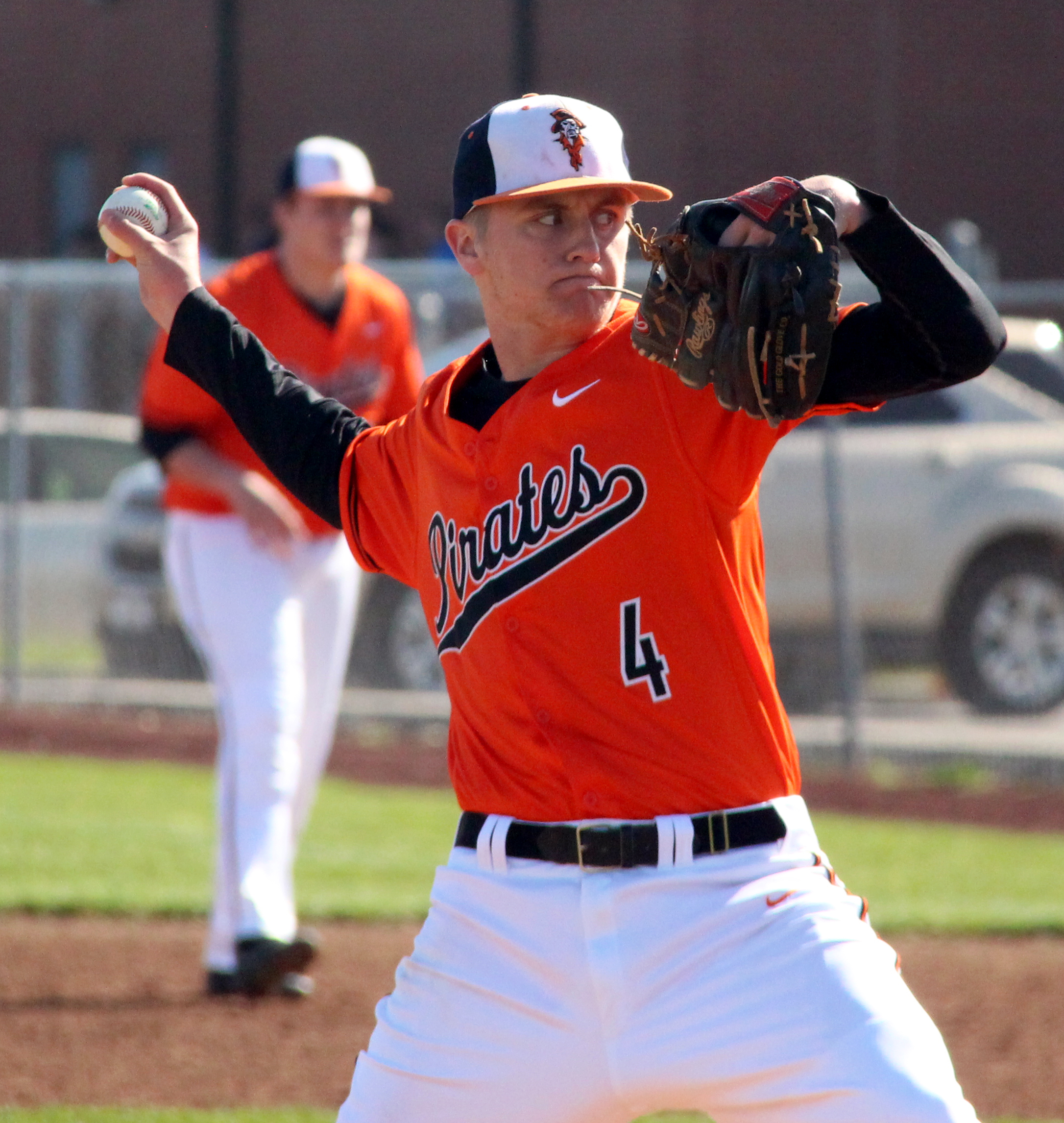 ROSS MARTIN/Citizen photos Platte County junior Jared Wilson delivers a pitch in a game against Oak Grove on Monday, March 28 at Platte County high School.