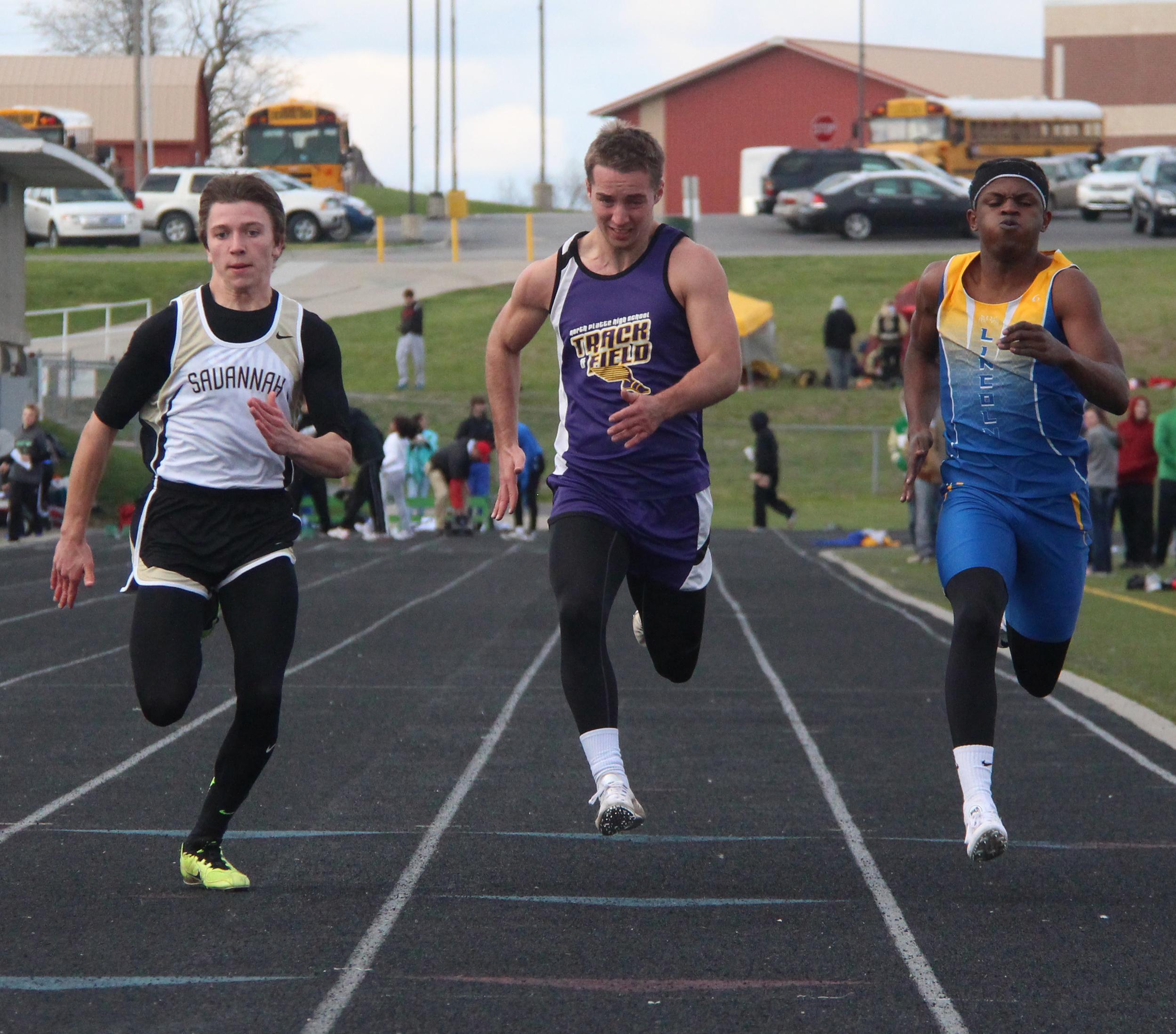 ROSS MARTIN/Citizen photo North Platte senior Jordan Hendricks, center, puts his head down as he finishes the 100-meter dash race Friday, April 1 in the Smithville Invitational at Smithville High School.