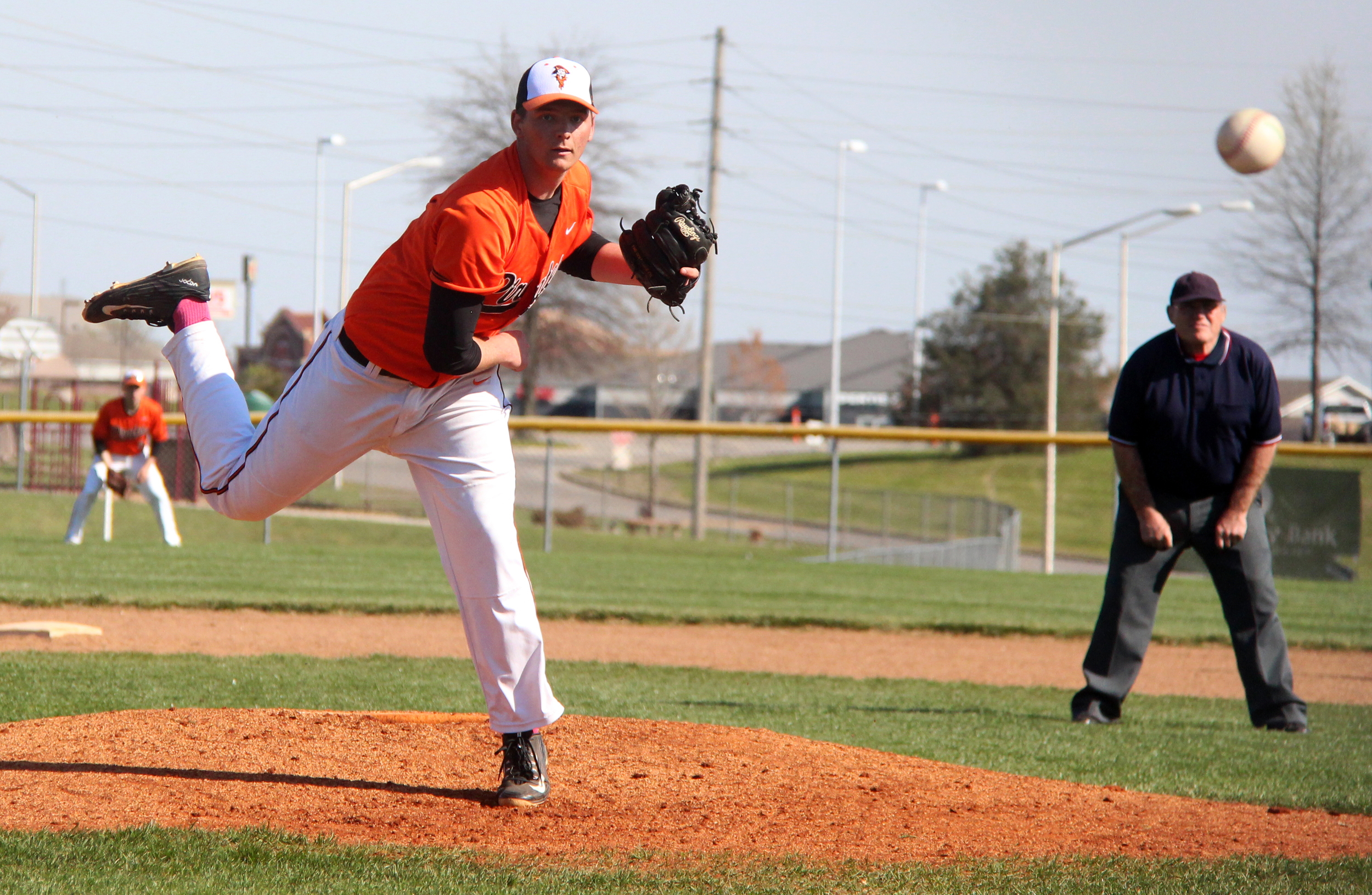 ROSS MARTIN/Citizen photo Platte County junior Grant Carver follows through on a pitch against Park Hill on Wednesday, April 13 at Platte County High School.