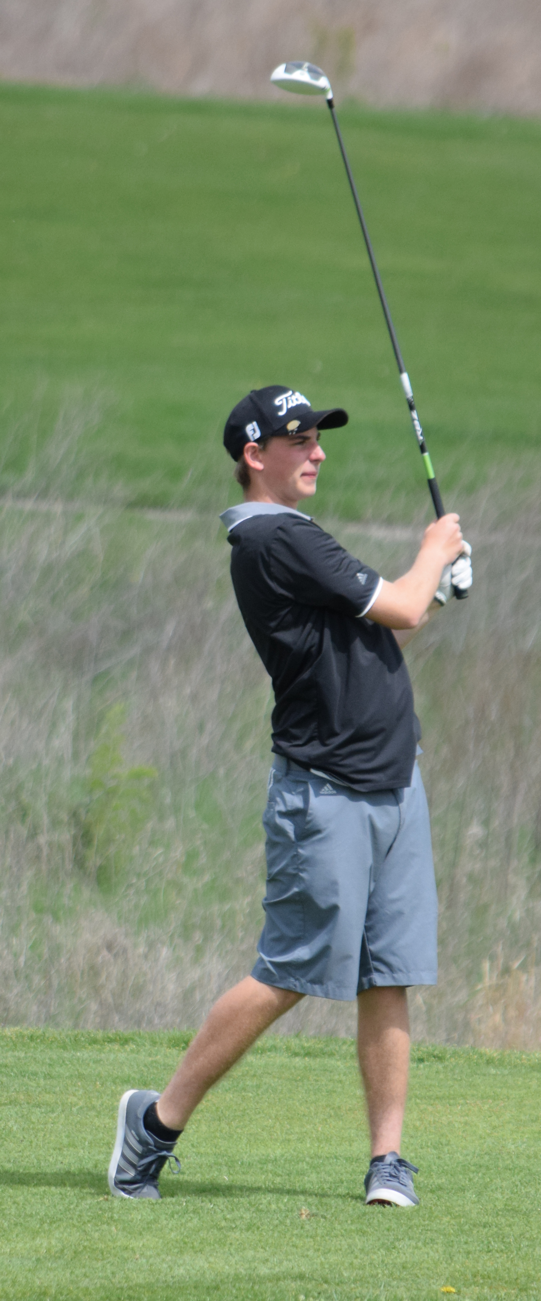 BRYCE MERENESS/Citizen photo Platte County senior Jagger Zoellner watches a tee shot at the Suburban Conference Blue Division championships held Monday, April 25 on the Posse Course at Paradise Pointe Golf Complex in Smithville, Mo.