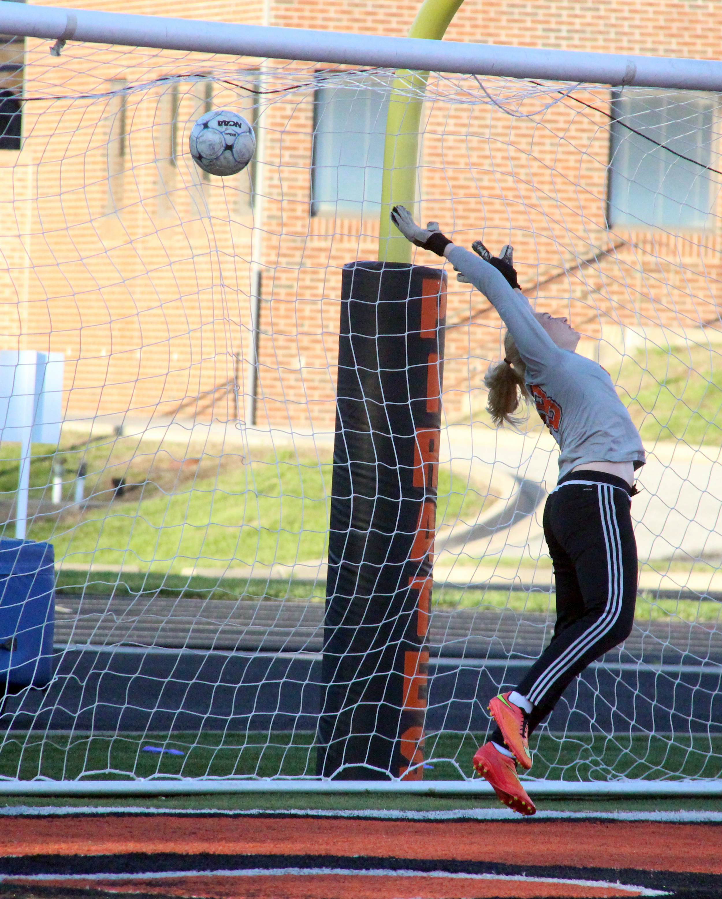 ROSS MARTIN/Citizen photo Platte County goalkeeper Faith Burtchell tips the ball while trying to save a penalty kick against Kearney on Wednesday, April 27 at Pirate Stadium.