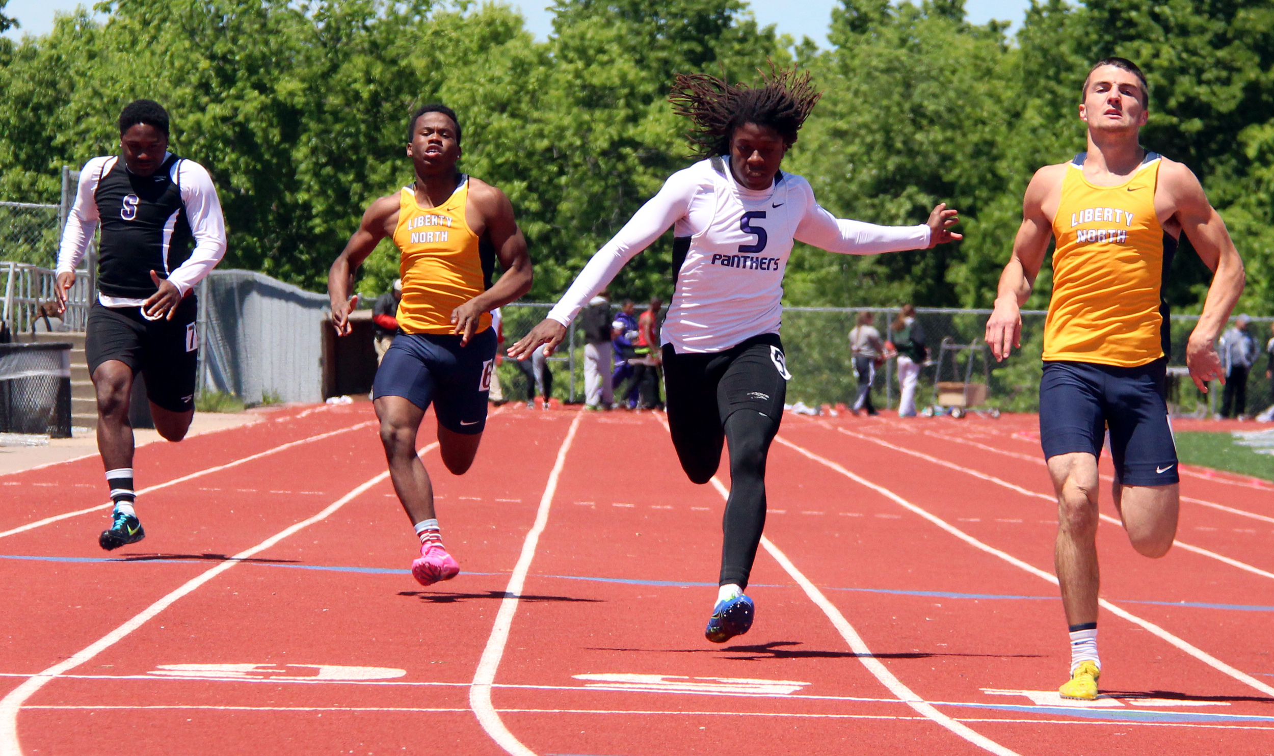 ROSS MARTIN/Citizen photo Park Hill South's Nylo Clarke, center, finishes second in the Class 5 District 8 100-meter dash Saturday, May 14 at Excelsior Springs High School in Excelsior Springs, Mo.