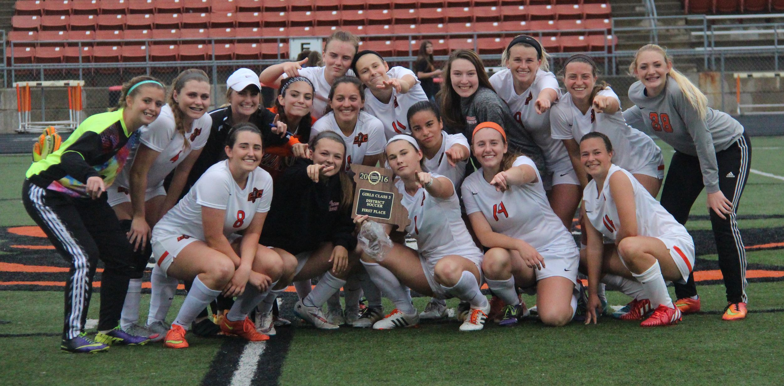 ROSS MARTIN/Citizen photo Platte County players celebrate with the Class 3 District 16 championship plaque following a 2-1 overtime win against Smithville on Thursday, May 19 at Pirate Stadium.