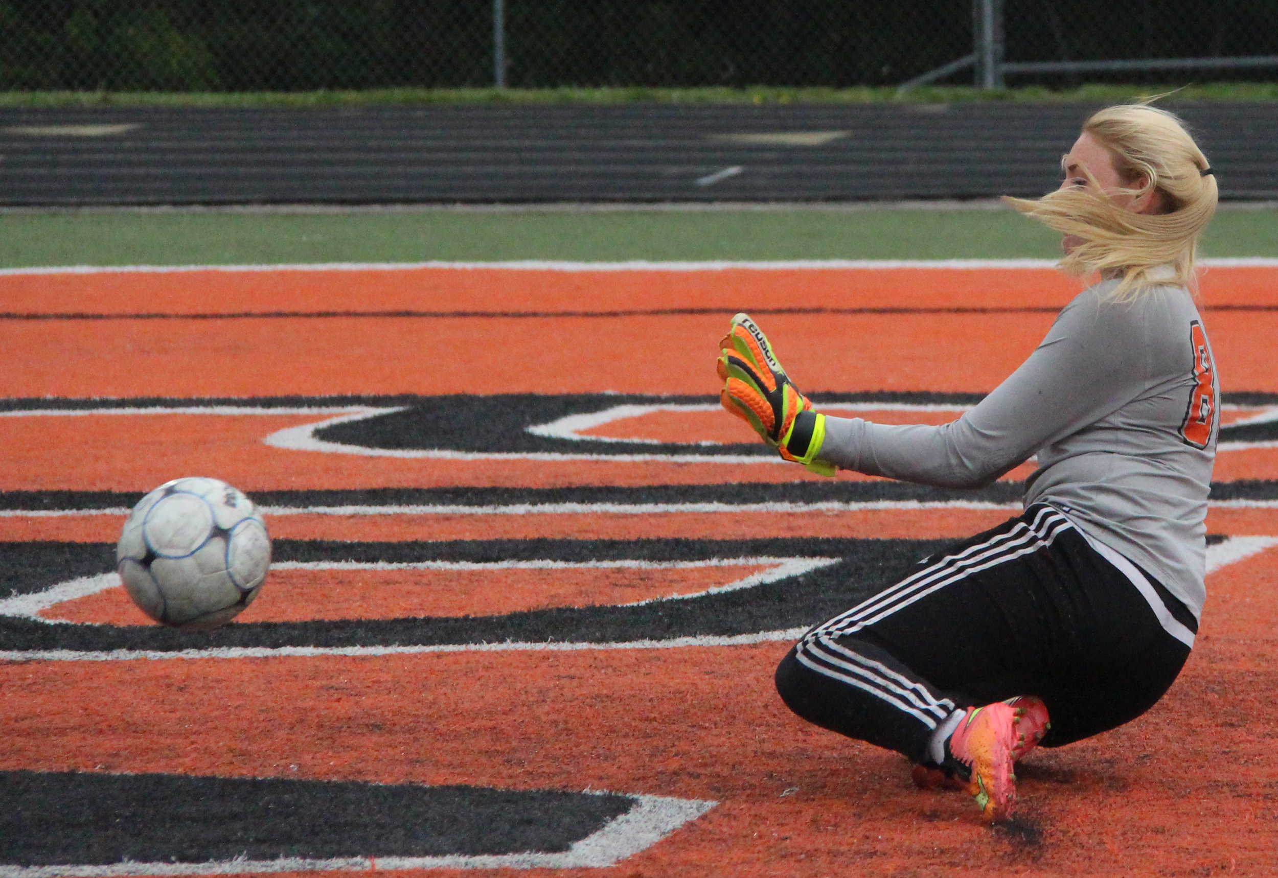 ROSS MARTIN/Citizen photo Platte County sophomore goalkeeper Faith Burtchell goes down to try and block a shot Thursday, May 19 against Smithville at Pirate Stadium.