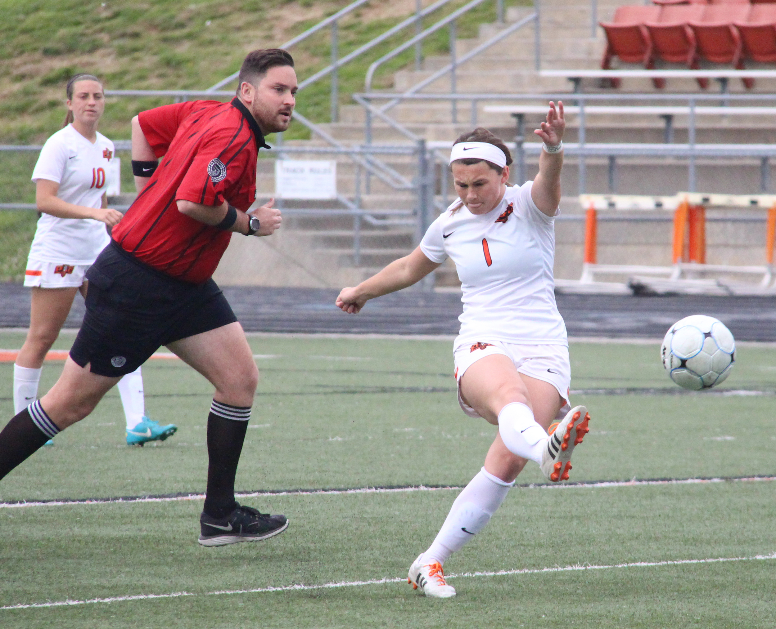 ROSS MARTIN/Citizen photo Platte County senior midfielder Brooke Zenner hits a pass during the first half of the Class 3 District 16 championship game against Smithville on Thursday, May 19 at Pirate Stadium.