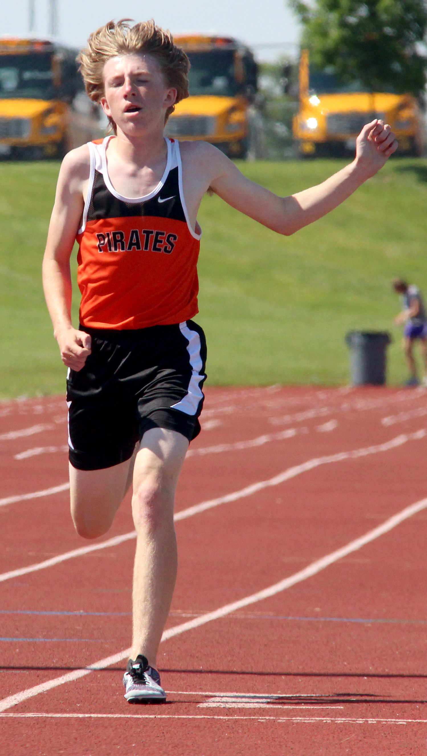 ROSS MARTIN/Citizen photos Platte County freshman Jackson Letcher strides out to finish the 3,200 in fourth place.