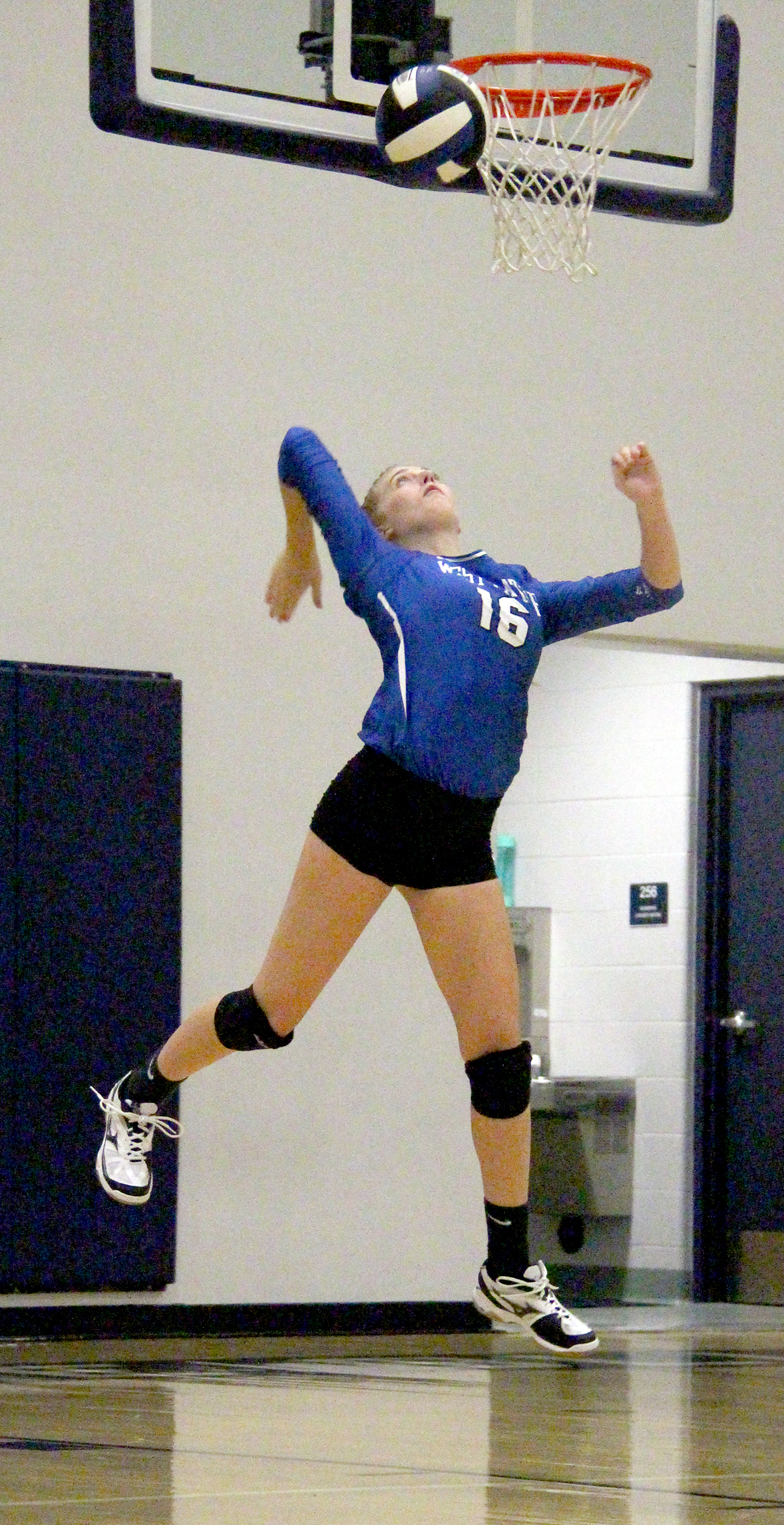 ROSS MARTIN/Citizen photo West Platte senior setter Megan Kottman hits a serve during the Bluejays' 2-1 win against East Buchanan on Thursday, Sept. 1 at West Platte High School in Weston, Mo.