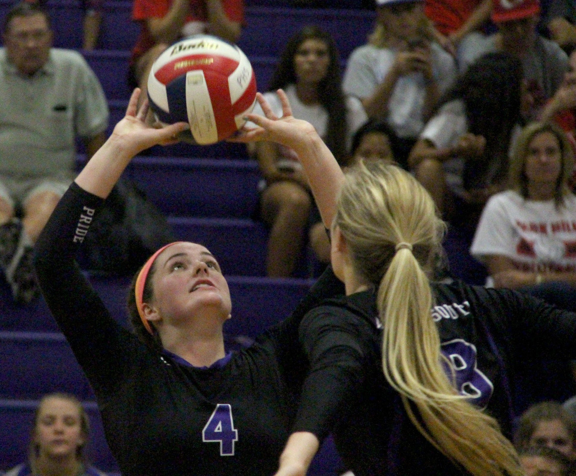 ROSS MARTIN/Citizen photo Park Hill South senior Allison Sadler (4) prepares to set for junior middle hitter Annika Welty during a match Wednesday, Sept. 7 at Park Hill South High School in Riverside, Mo.