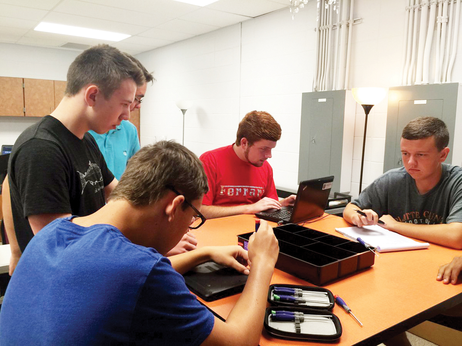 Contributed photo Members of the Platte County High School's Cyber Crew (from left): Bradley Morgan, Will Valentine, Cody Bishop, John Teer and Zach Pixler work on a Google Chromebook tablet during class. The district started a special class to allow students the chance to help resolve issues with the new devices.