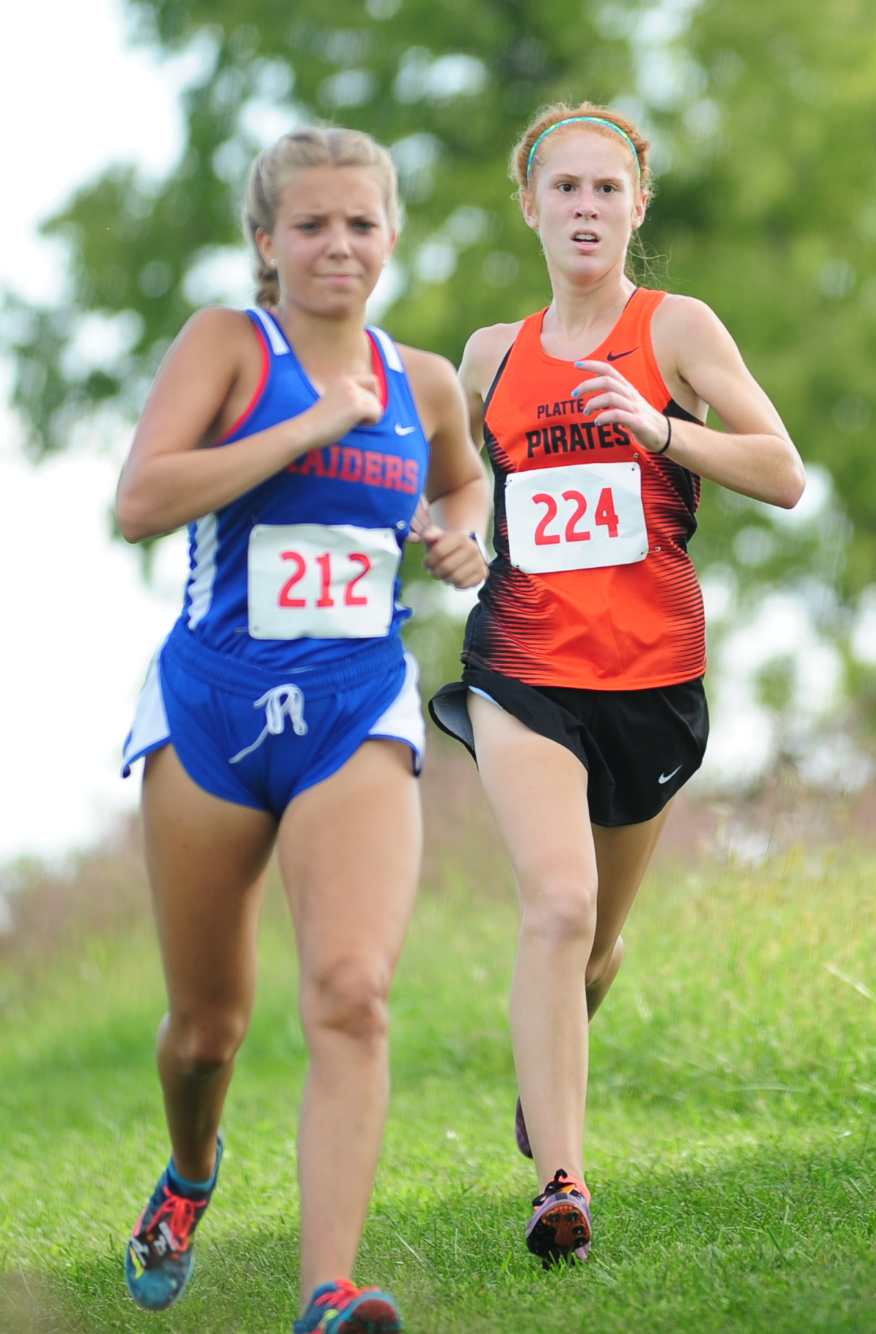 NICK INGRAM/Citizen photo Platte County junior Erin Straubel (224) works to pass a runner.