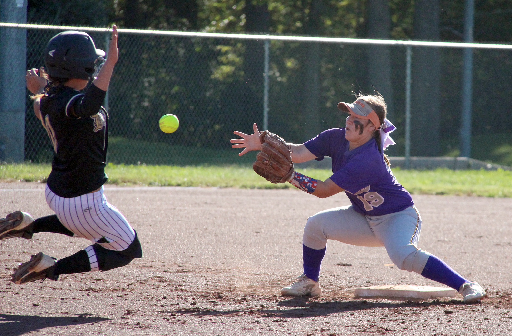 ROSS MARTIN/Citizen photo North Platte shortstop Alley Rickel, left, prepares to take a throw and tag out DeKalb's Kirstian Goddard during a game Monday, Sept. 26 at Dean Park in Dearborn, Mo.