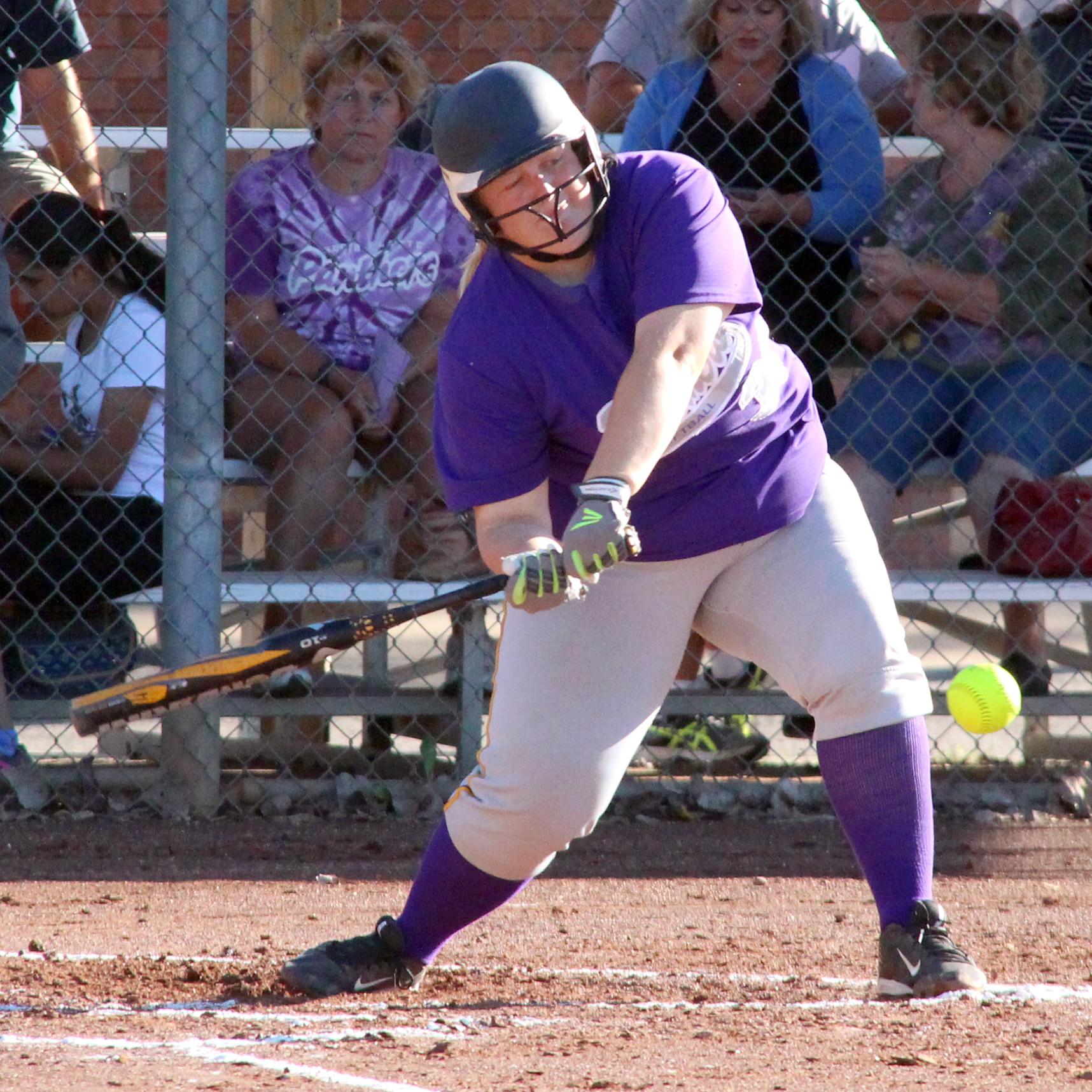 ROSS MARTIN/Citizen photo North Platte junior first baseman Miranda Daniel smacks a two-run single for the Panthers against DeKalb on Monday, Sept. 26 at Dean Park in Dearborn, Mo.