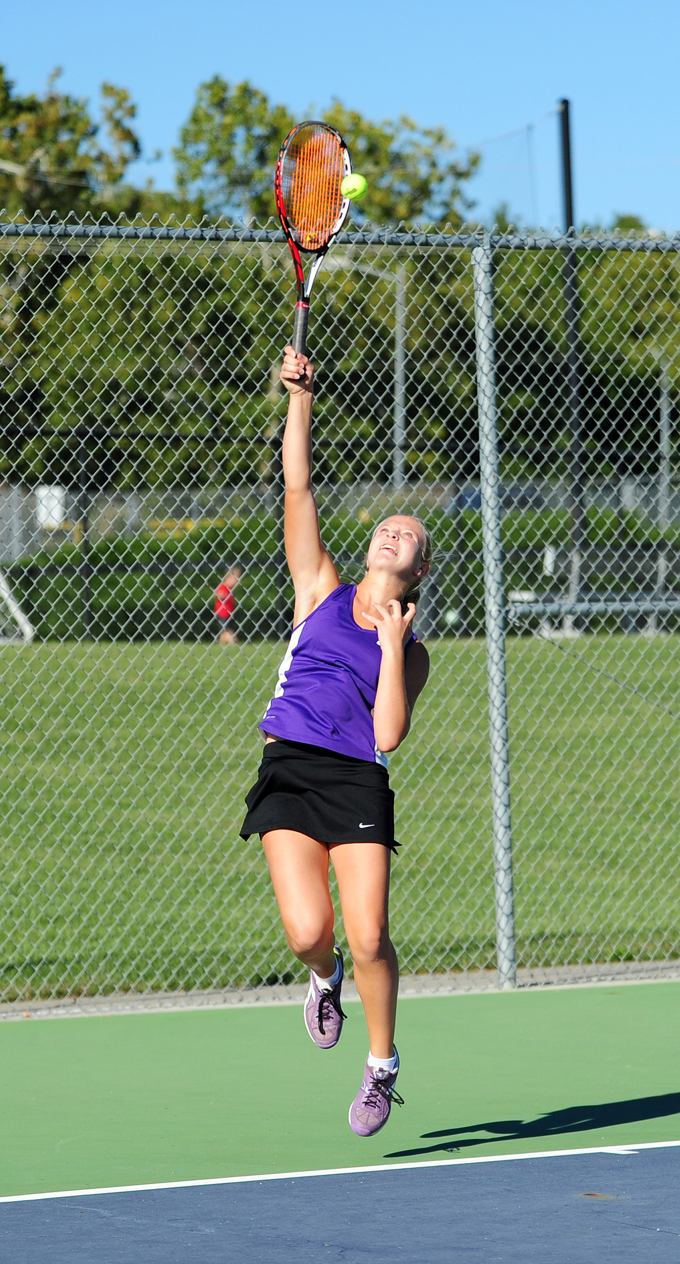 NICK INGRAM/Citizen photo Park Hill South freshman Chloe Norris hits a serve during a Class 2 District 15 semifinal dual with Park Hill on Tuesday, Sept. 27.