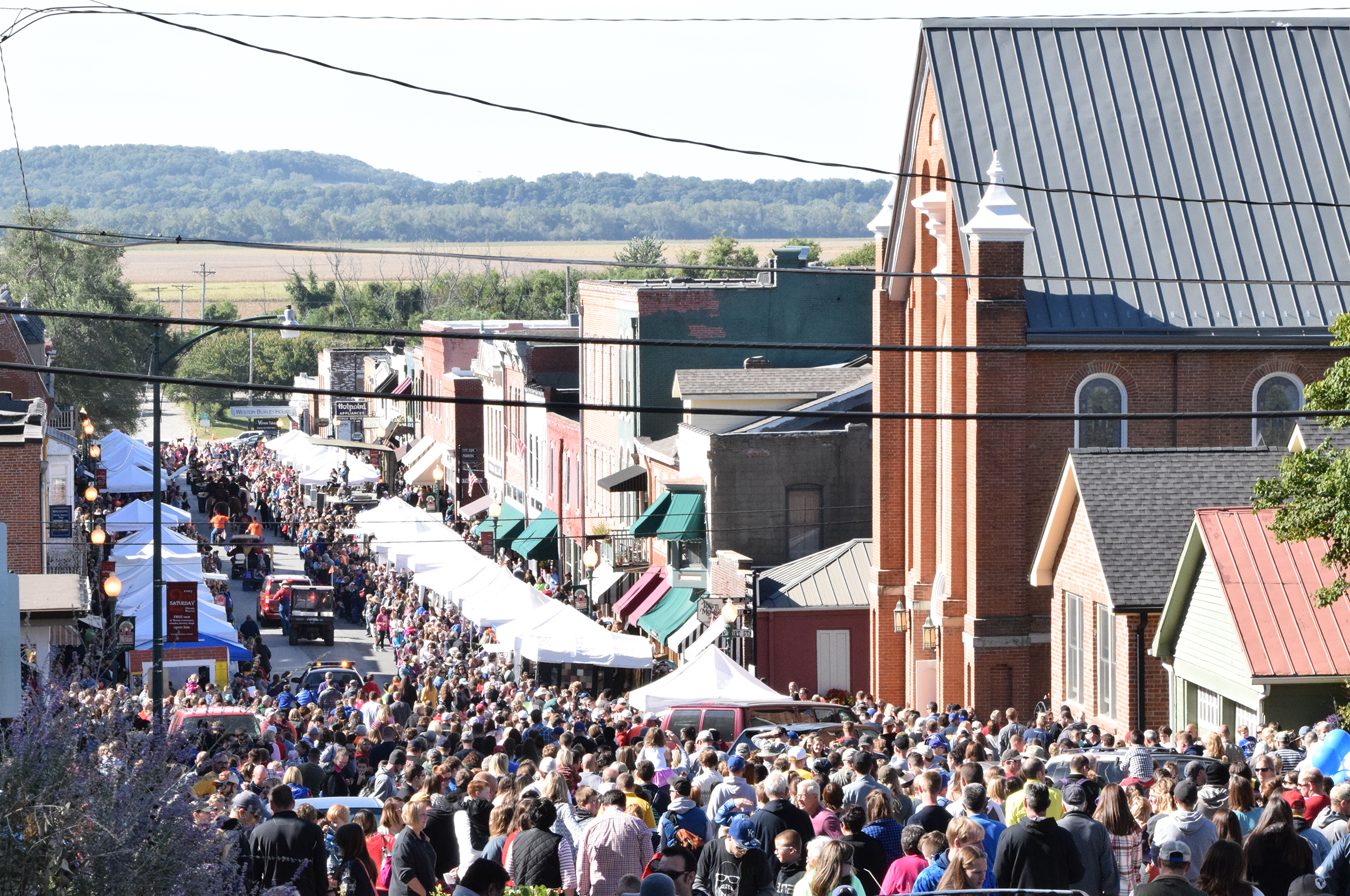 Citizen file photo People at last year's Applefest crowded Main Street in Weston, Mo. The annual festival is scheduled for this weekend, Saturday and Sunday, Oct. 1-2, and expects to continue bringing a large number of visitors to the city.