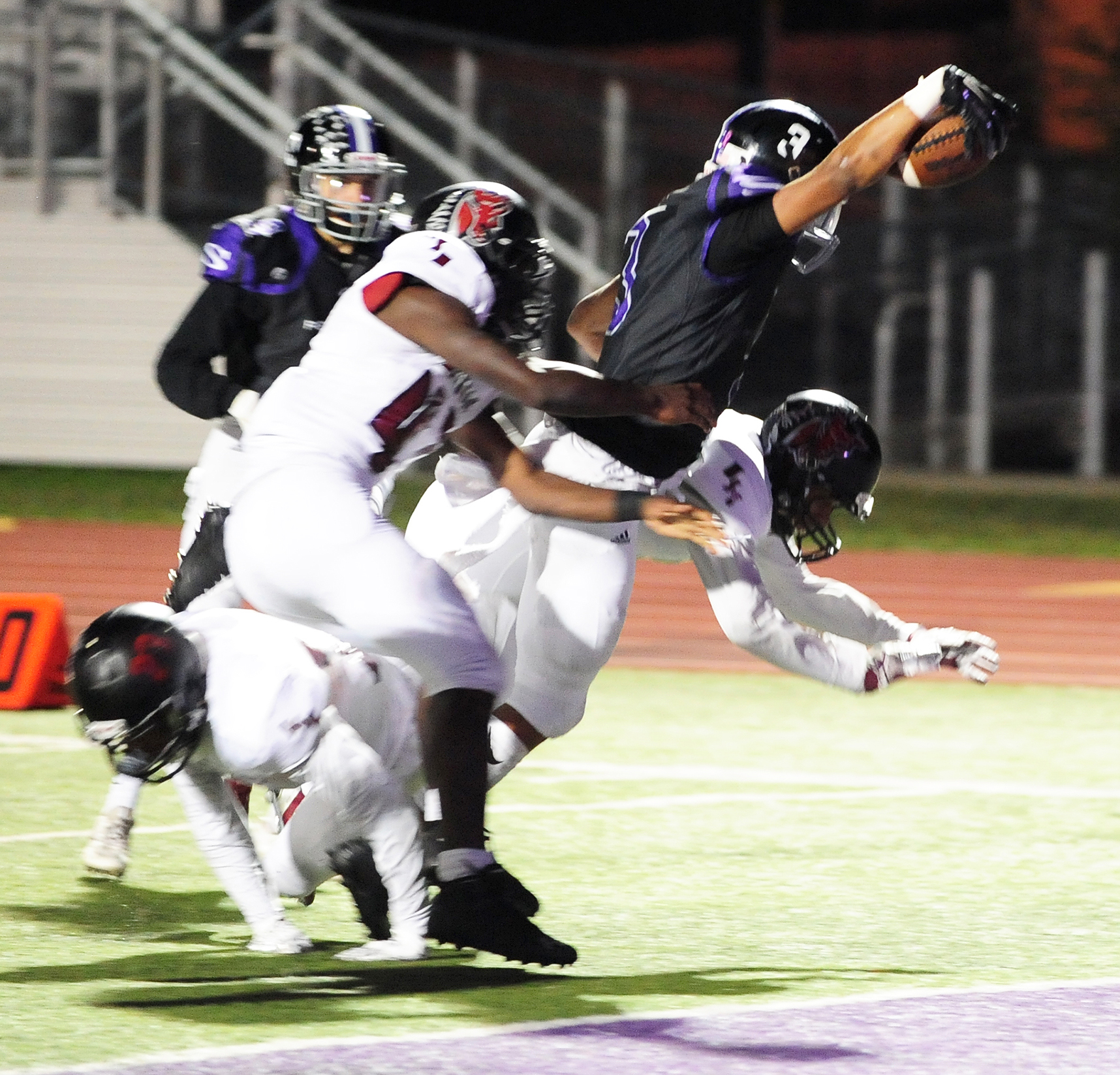 NICK INGRAM/Citizen photo Park Hill South senior wide receiver Jake Springer (3) reaches the ball over the goal line for a first half touchdown Friday, Oct. 7 against Lee's Summit North at Park Hill District Stadium in Kansas City, Mo.