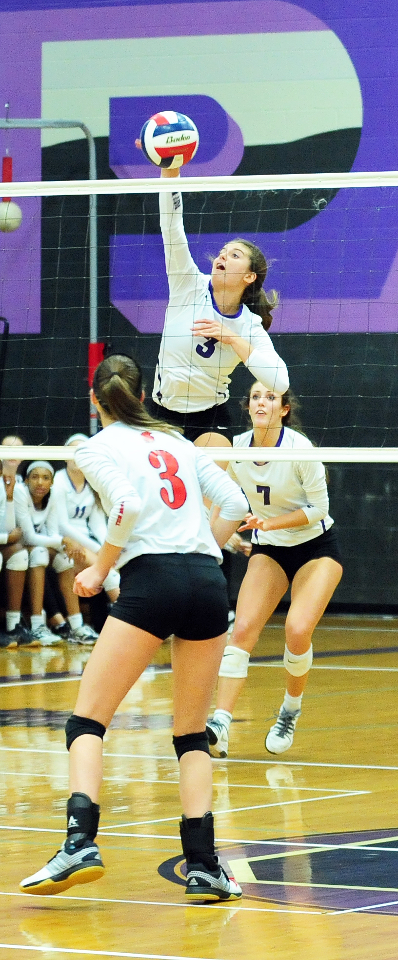 NICK INGRAM/Citizen photo Park Hill South senior Sarah Knight (3) hits a spike against Park Hill in the Class 4 District 16 championship match held Wednesday, Oct. 19 at Park Hill South High School in Riverside, Mo.